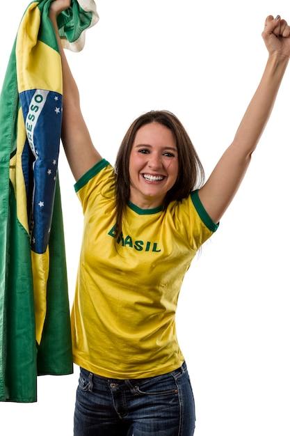 Ventilador brasileño femenino celebrando en un espacio en blanco. Foto Premium
