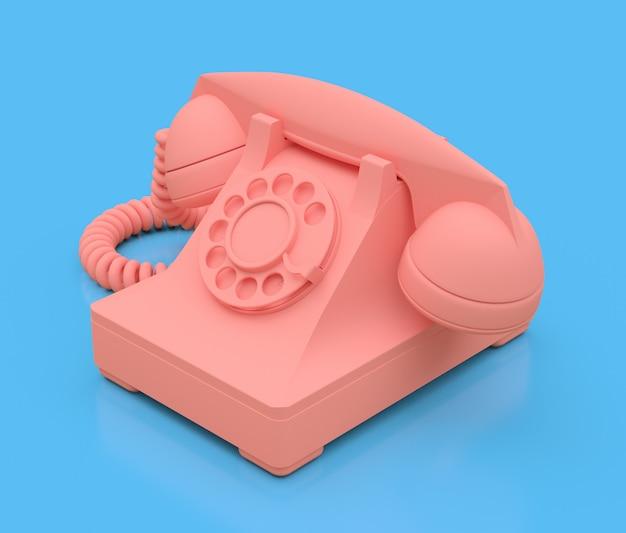 Viejo teléfono de marcación rosa sobre una superficie azul Foto Premium