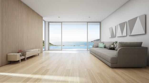 Vista al mar salón de lujo casa de verano en la playa con piscina y terraza de madera. Foto Premium
