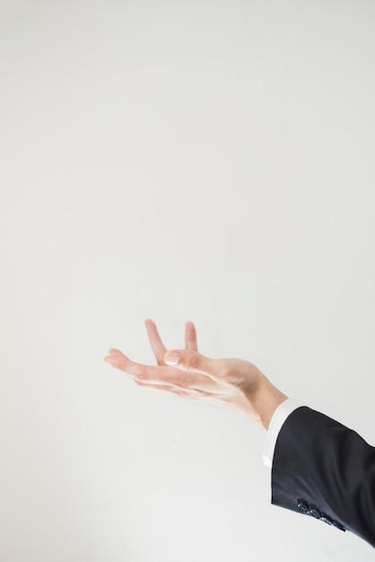 Vista lateral de la mano con espacio de copia Foto gratis