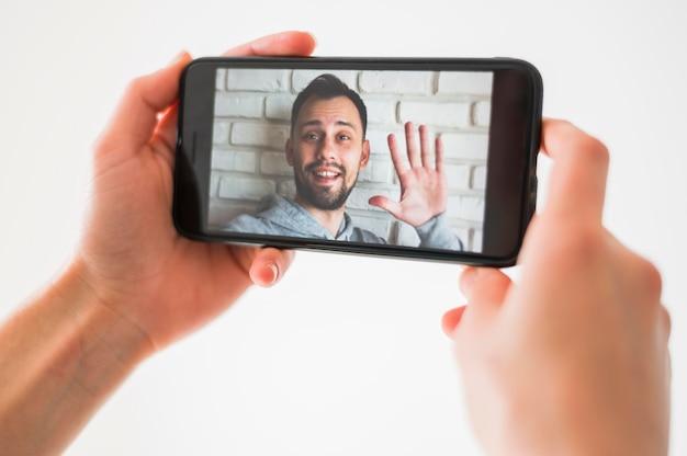 Vista de primer plano del concepto de video llamada Foto gratis