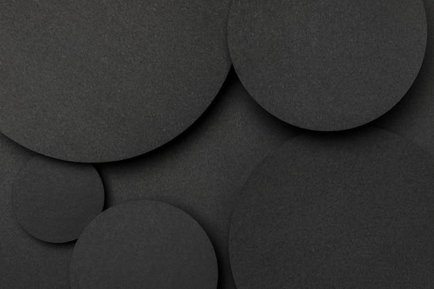 Vista superior grandes puntos de fondo de papel negro Foto Premium