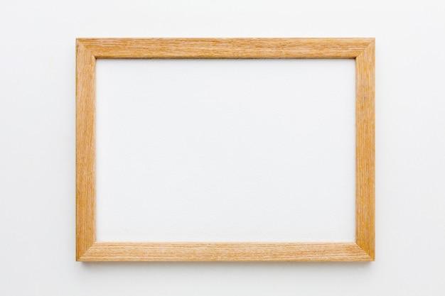 Vista superior del hermoso concepto de marco de madera Foto Premium