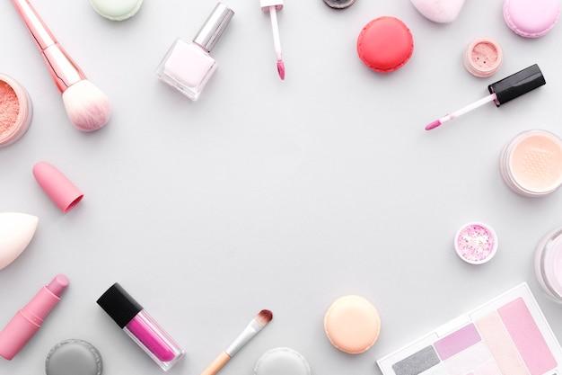 Vista superior marco de maquillaje Foto gratis