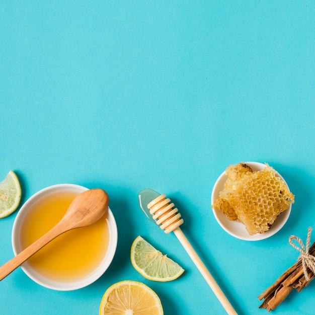 Vista superior miel con limón Foto gratis