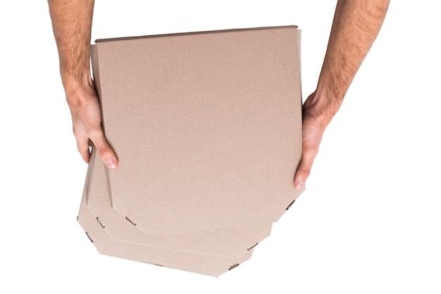 Vista superior pila de cajas con pizza Foto gratis