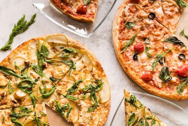 Vista superior pizzas Foto gratis