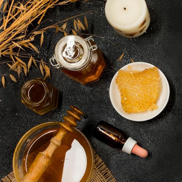 Vista superior productos de miel Foto gratis