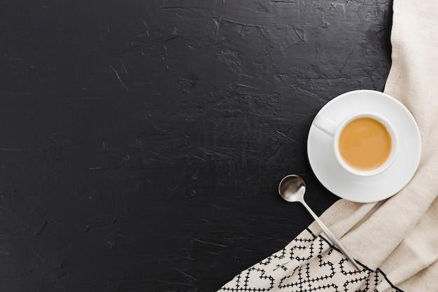Vista superior de la taza de café con cuchara Foto gratis
