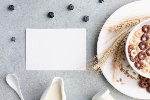 Vista superior tazón de cereal con maqueta Foto gratis