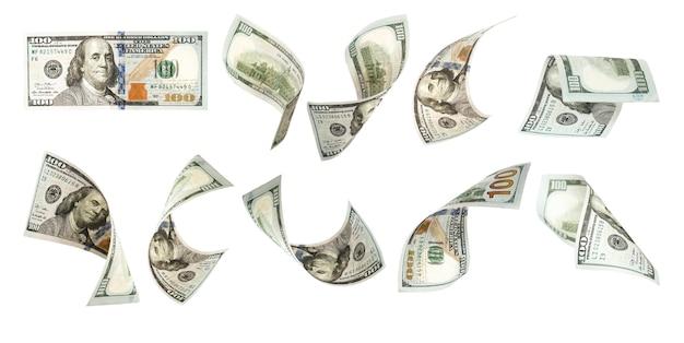 Vuelo de cien billetes de dólar en blanco. Foto Premium
