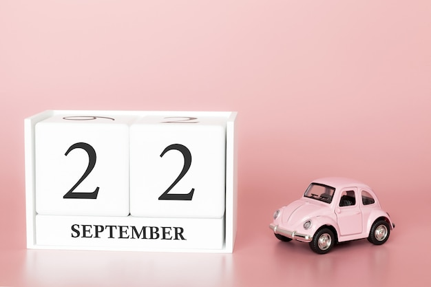 22 settembre. giorno 22 del mese. cubo calendario con auto Foto Premium