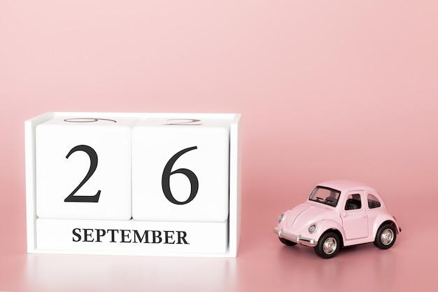 26 settembre. giorno 26 del mese. cubo calendario con auto Foto Premium