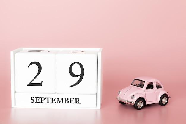 29 settembre. giorno 29 del mese. cubo calendario con auto Foto Premium