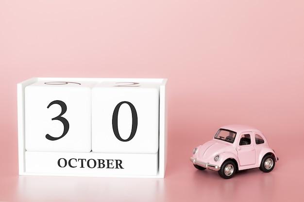 30 ottobre. giorno 30 del mese. cubo calendario con auto Foto Premium