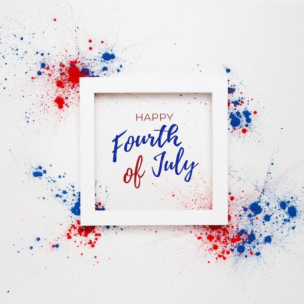 4 luglio sfondo con scritte in una cornice e fuochi d'artificio realizzati con macchie di colore holi Foto Gratuite