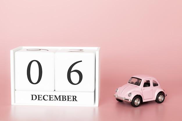 6 dicembre. 6 ° giorno del mese cubo calendario con auto Foto Premium