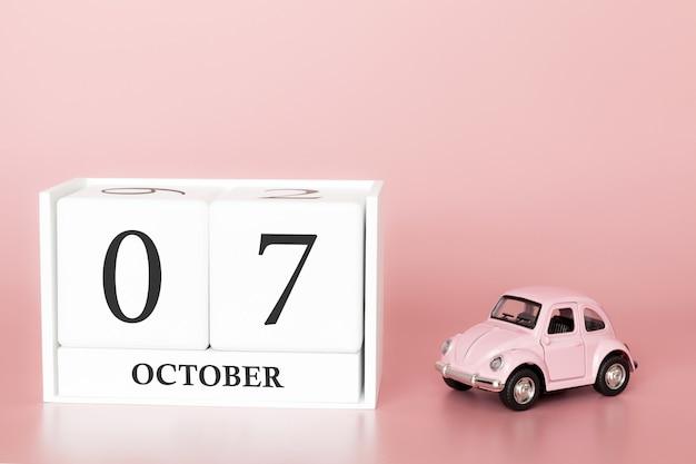 7 ottobre. 7 ° giorno del mese cubo calendario con auto Foto Premium