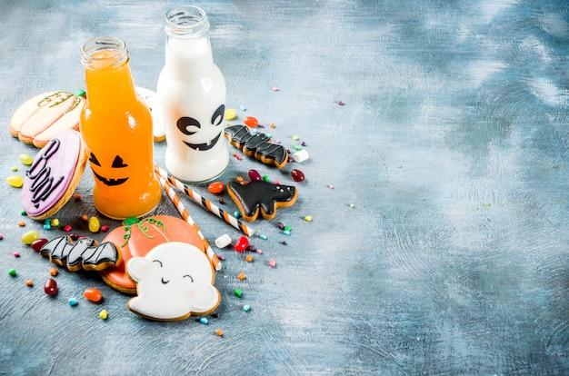 Alimento di halloween, scatola del pranzo di scuola con la bottiglia della bevanda della zucca Foto Premium