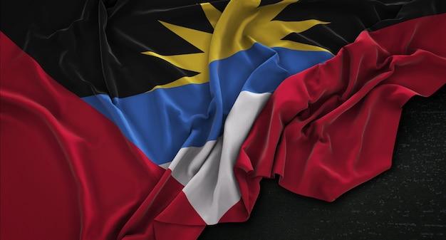 Antigua e barbuda bandiera ruggiata su sfondo scuro 3d rendering Foto Gratuite