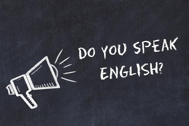 Apprendimento del concetto di lingue straniere. simbolo di gesso dell'altoparlante con frase parli inglese Foto Premium