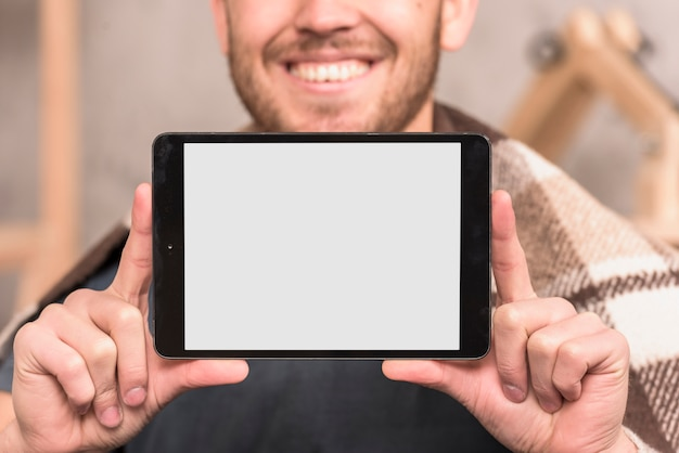 Artista che presenta tablet Foto Gratuite