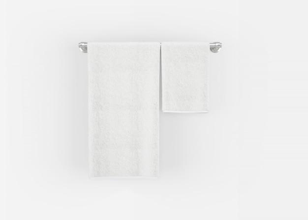 Asciugamani su una gruccia su un muro grigio Foto Gratuite
