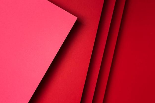 Assortimento di vista superiore del fondo rosso degli strati di carta Foto Gratuite