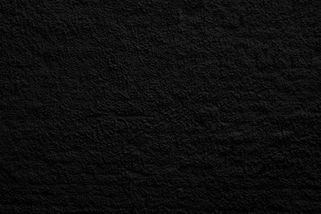 Astratto sfondo nero. irregolarità irregolari nell'intonaco. superficie della parete. Foto Premium