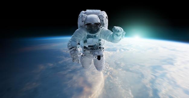 Astronauta che galleggia nella rappresentazione dello spazio 3d Foto Premium