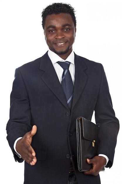 Attraente uomo d'affari africano su uno sfondo bianco Foto Premium