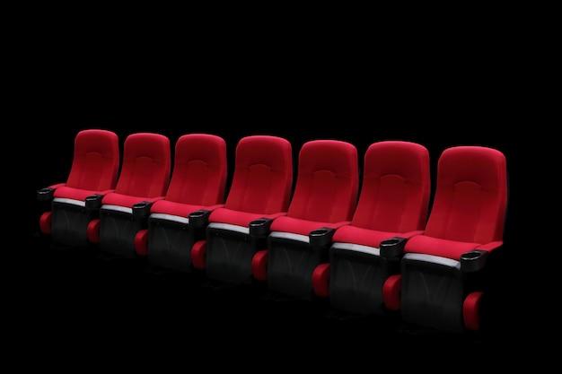 Auditorium teatro vuoto o cinema con sedili rossi una fila Foto Premium