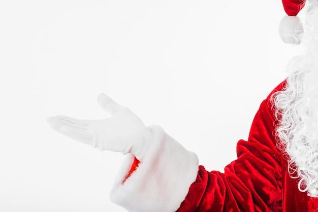 Babbo natale in rosso mostrando qualcosa con la mano Foto Gratuite