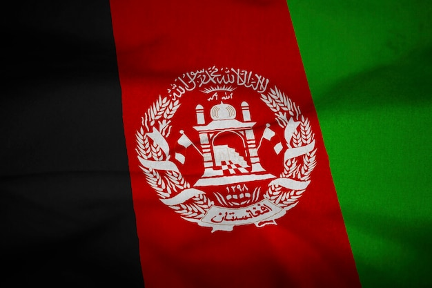 Bandiera increspata dell'afghanistan che soffia nel vento Foto Premium