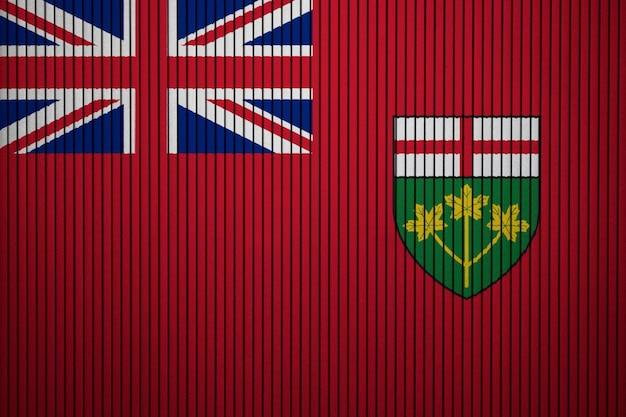 Bandiera nazionale dipinta dell'ontario su un muro di cemento Foto Premium