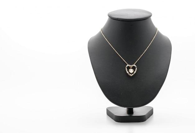 Bella e collana di lusso sul collo del basamento dei monili Foto Gratuite
