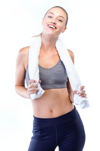 Bella giovane donna in posa dopo aver fatto pilates su sfondo bianco. Foto Gratuite