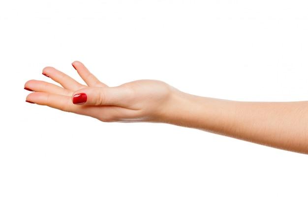 Bella tenuta del segno della mano della donna isolata su bianco Foto Premium