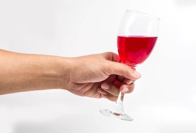 Bicchiere Di Vino Rosso In Mano Su Sfondo Bianco Scaricare Foto