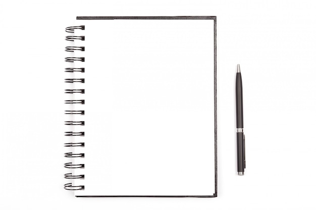 Blocco note e una penna Foto Premium