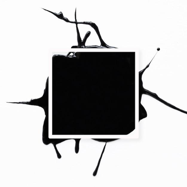 Blocco per grafici astratto con splatter nero su bianco Foto Gratuite