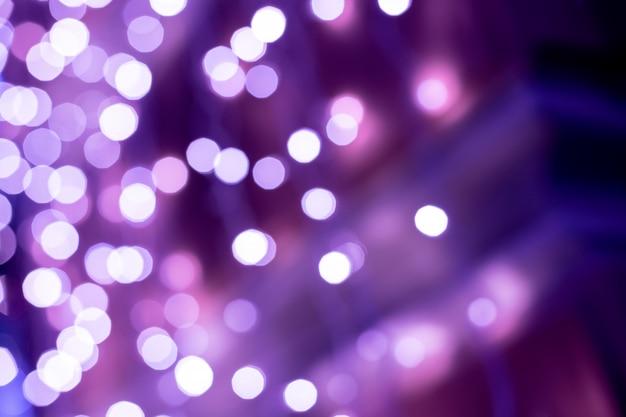 Bokeh viola sfocato sfondo di luci Foto Premium