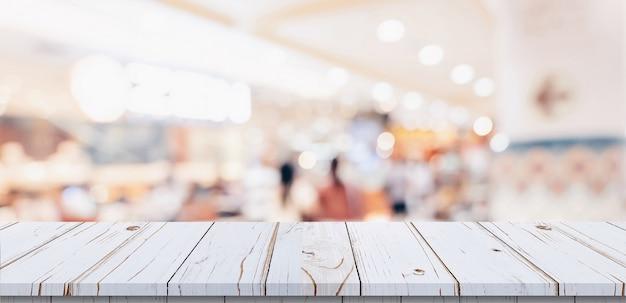 Bordi di legno bianchi sul centro commerciale Foto Premium