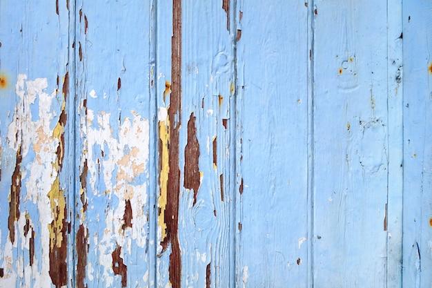 Bordo di legno anziano dipinto fondo blu Foto Premium