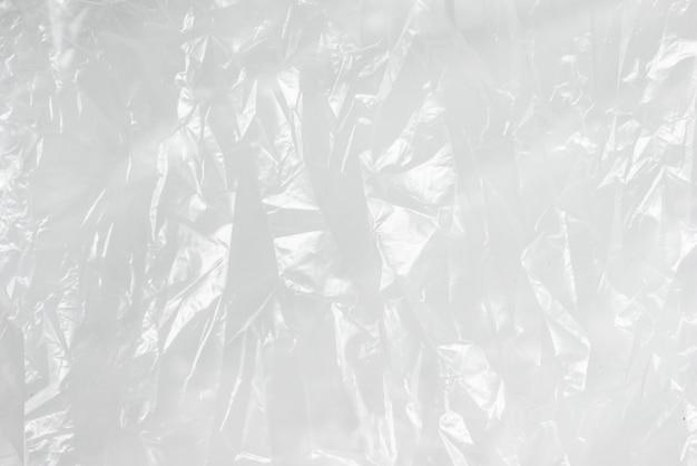 Borsa di immondizia bianca di struttura del film sgualcito fondo astratto Foto Premium