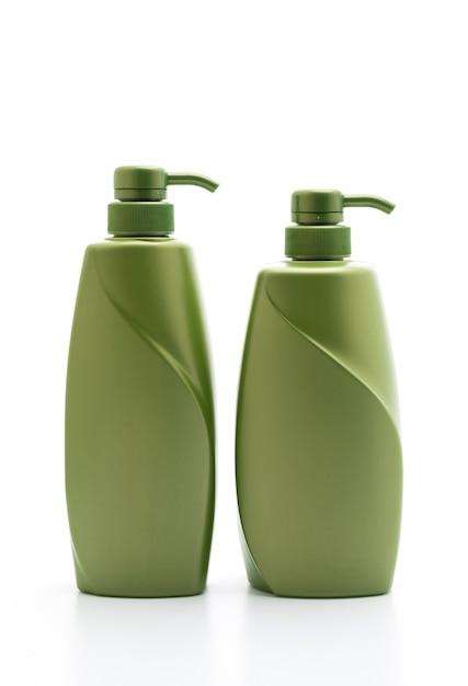 Bottiglia del condizionatore di capelli o dello sciampo su fondo bianco Foto Premium