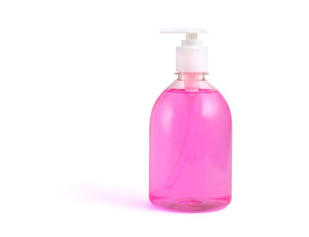 Bottiglia di sapone liquido rosa su uno sfondo bianco isolato. Foto Premium
