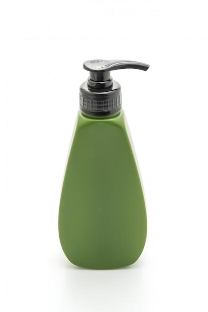 Bottiglia di shampoo o balsamo per capelli su bianco Foto Premium