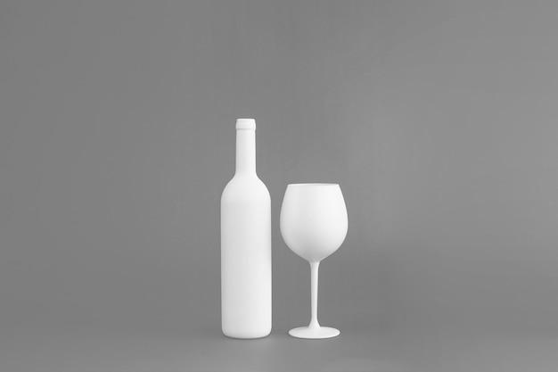 Bottiglia di vino e mockup di vetro Foto Gratuite