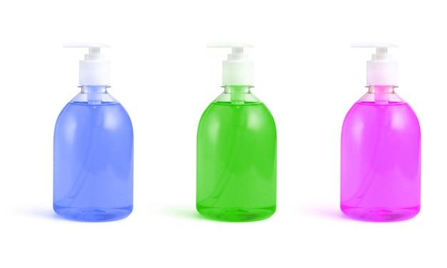 Bottiglie di sapone liquido rosa, verde e blu su un bianco isolato Foto Premium